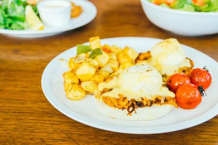 benedict: Egg benedict in white plate for breakfast