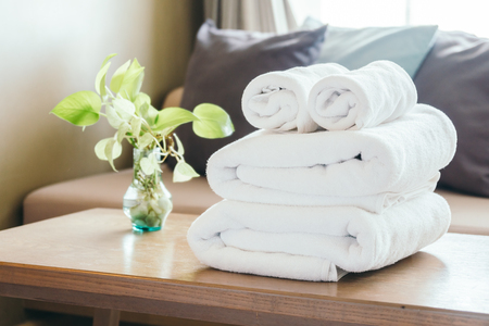 Stack of Towel on table with vase plant