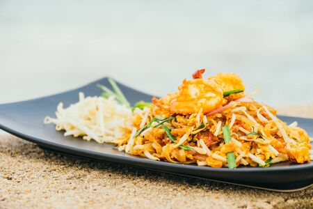 Stir fried noodles with prawn and shrimp in plate or Pad Thai Stock Photo