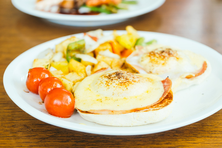benedict: Egg benedict with vegetable for breakfast in white plate