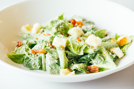 Grilled caesar salad with fresh vegetable in white plate - Healthy food style