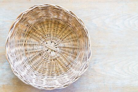 Wicket basket on wooden table