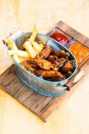Fried chicken wing with french fries with sauce