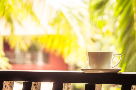 White coffee cup around outdoor patio - Filter Processing
