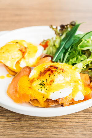 benedict: Eggs benedict with smoked salmon in white plate for breakfast Stock Photo
