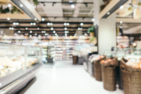 Abstract blur and defocused supermarket shopping in department store interior for background