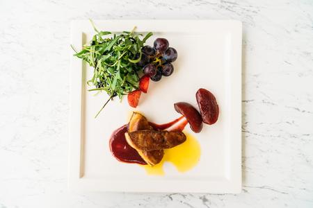 Foie gras with vegetable and fruit in white plate Lizenzfreie Bilder