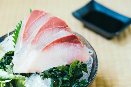 Raw with fresh hamachi fish meat sashimi - Japanese food style Lizenzfreie Bilder