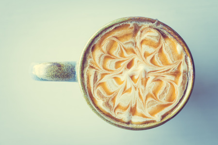 Hot latte caramel macchiato cup on wooden table