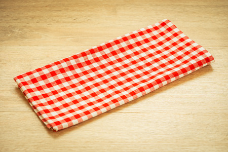 Kitchen cloth on wood table with copy space - Vintage Filter