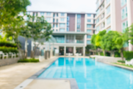 Abstract blur and defocus swimming pool in hotel and resort for background