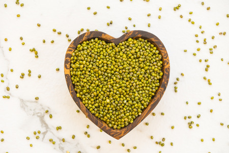 Green mung beans in wooden bowl - Healthy and nutririon food concept style Stock Photo