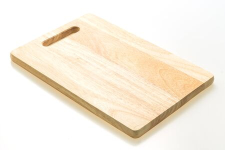 Brown wooden chopping and cutting board isolated on white background