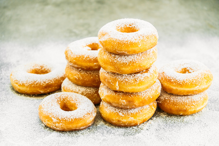 Sweet dessert with many donut on top with sugar icing - Unhealthy food style Archivio Fotografico