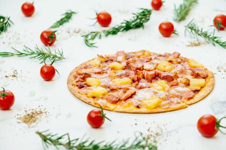 Hawaiian pizza with pineapple and ham - Unhealthy food style Stock Photo