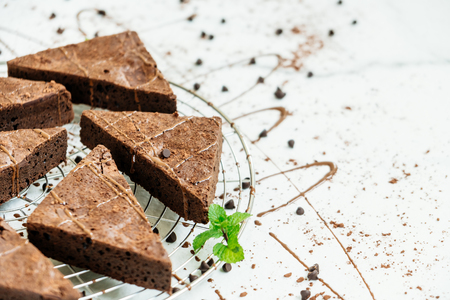 Sweet dessert with chocolate brownies on white stone background