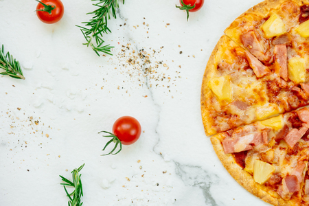 Hawaiian pizza with pineapple and ham - Unhealthy food style Standard-Bild