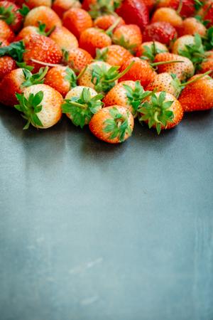 Strawberry fruit on black stone background with copy space Standard-Bild