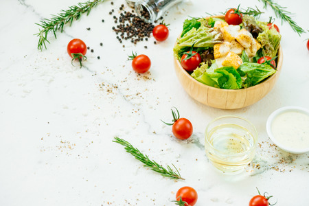 Clean and healthy food style with Caesar salad in wooden bowl Standard-Bild