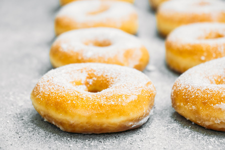 Sweet dessert with many donut on top with sugar icing - Unhealthy food style Standard-Bild