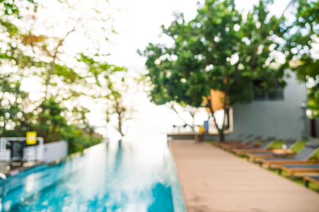 Abstract blur outdoor swimming pool in hotel and resort for background