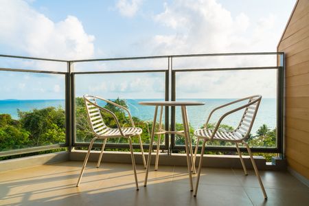 Beautiful outdoor patio with chair and table and sea view background
