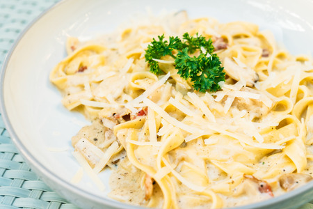 Spaghetti or Pasta with truffle and cream sauce in white plate - Italian food style Stock Photo
