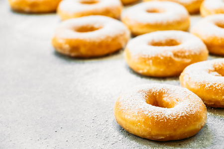 Sweet dessert with many donut on top with sugar icing - Unhealthy food style 스톡 콘텐츠