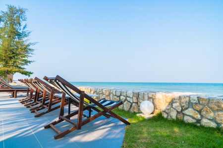 Beach bed and chair with beach and sea - Vacation concept Stok Fotoğraf