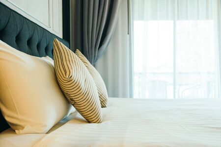 Comfortable pillow on bed decoration in hotel bedroom interior Stok Fotoğraf