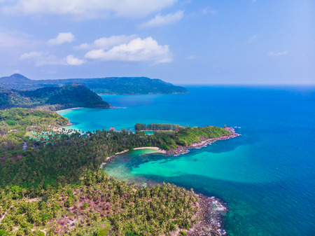 Aerial view of beautiful beach and sea with coconut palm tree on blue sky in the paradise island Banco de Imagens