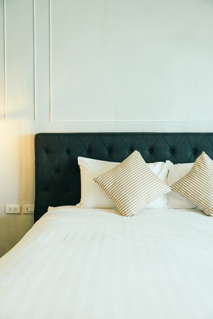 Comfortable pillow on bed decoration in hotel bedroom interior Stock Photo
