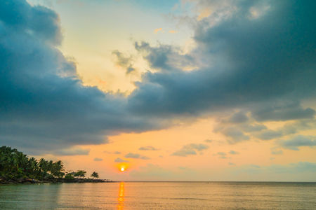 Beautiful paradise island with beach and sea around coconut palm tree at sunset time - Holiday Vacation and Travel concept