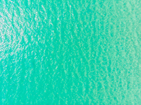 Aerial view of sea and ocean water reflection with sun light for background