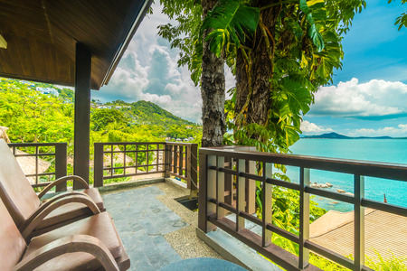 Patio or Balcony with chair around beautiful sea and ocean view for travel and vacation Stock Photo