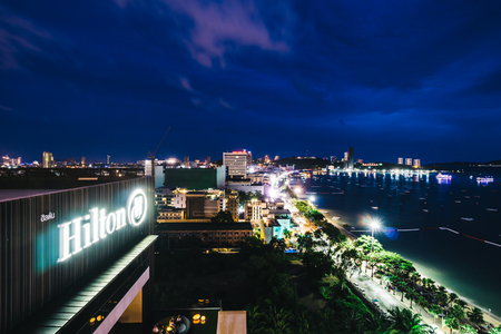 PATTAYA THAILAND : 9 June 2018 - Hilton hotel sign with pattaya city view around sea and beach at night