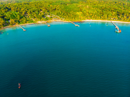 Beautiful Aerial view of beach and sea with coconut palm tree in paradise island for vacation