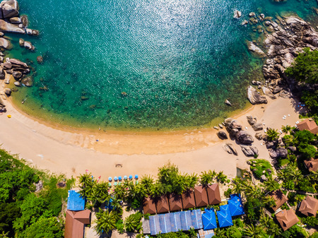 Aerial view of beautiful tropical beach and sea with palm and other tree in koh samui island for travel and vacation
