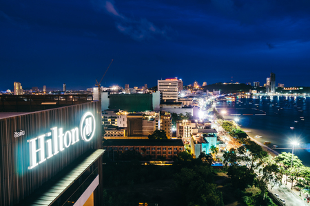 PATTAYA THAILAND : 9 June 2018 - Hilton hotel sign with pattaya city view around sea and beach at night