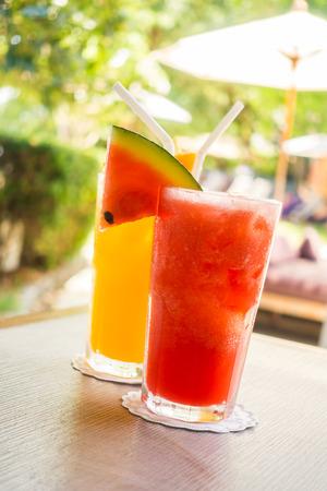 Waterlemon and orange juice in drinking glass on table - Healthy food style Stock fotó