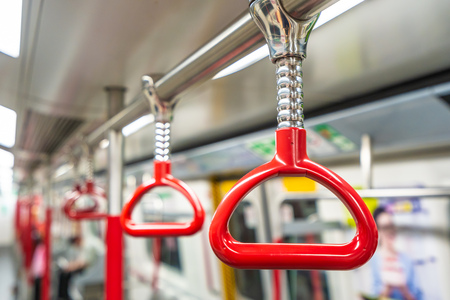 Red handrails in subway train station