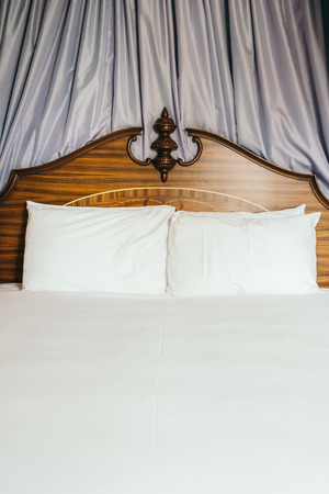 Beautiful comfortable white pillow on bed decoration in hotel bedroom interior