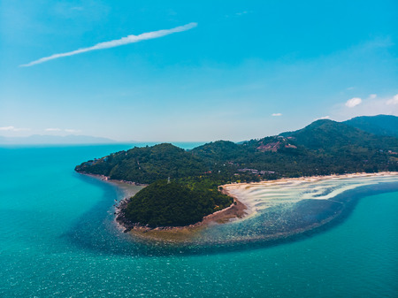 Aerial view of beautiful tropical beach and sea with trees on island for travel and vacation Imagens