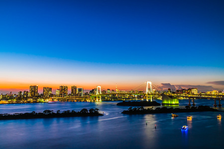 Beautiful architecture building cityscape of tokyo city with rainbow bridge at twilight sunset time in japan
