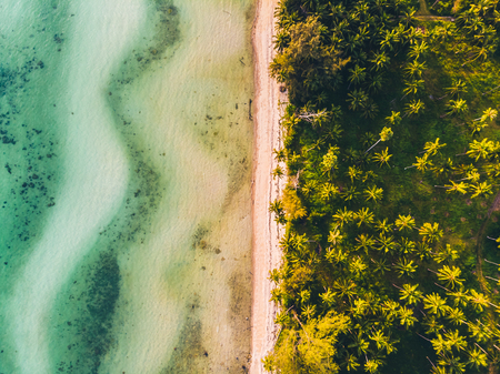 Aerial view of beautiful tropical beach and sea with trees on island for travel and vacation Imagens - 115504437