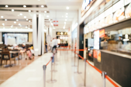 Abstract blur and defocused luxury shopping mall in department store for background