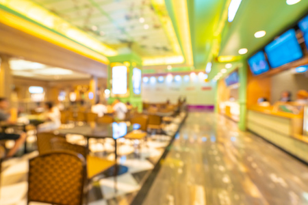 Abstract blur and defocused food court in shopping mall of department store for background