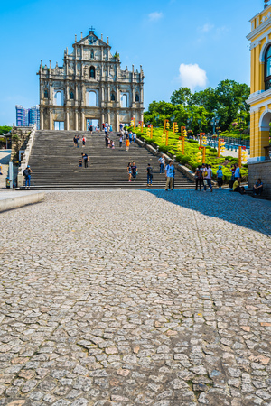 China, Macau - September 6 2018 - Beautiful old architecture building with ruin of st pual church landmark of macau city with blue sky background Imagens - 115507713