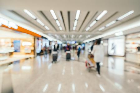 Flou abstrait et intérieur du terminal de l'aéroport défocalisé pour le fond