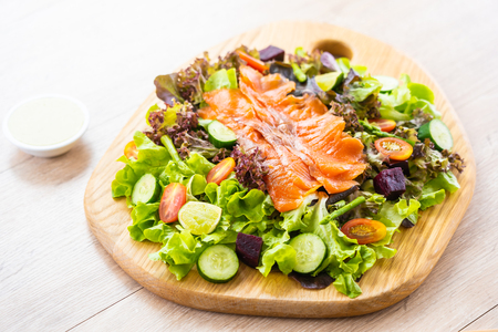 Raw Smoked salmon meat fish with fresh green vegetable salad and sauce - Healthy food concept Imagens - 115468487